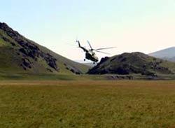 Вертолет на посадке